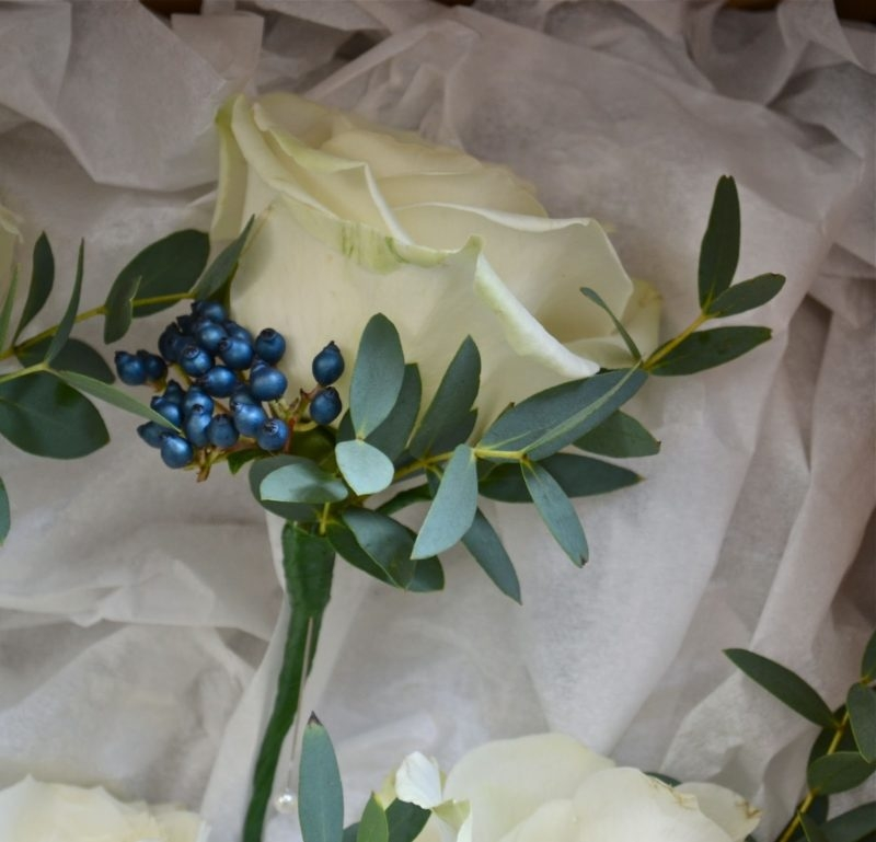 Boutonniere With A White Rose, Blue Berries And Eucalyptus